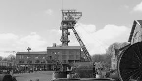 Black and white photograph of and old mining tower
