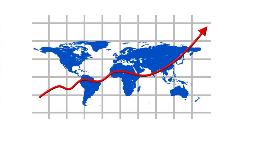 A red upward sloping arrow in front of a world map