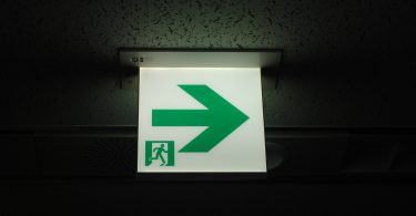 Emergency exit sign on a dark background